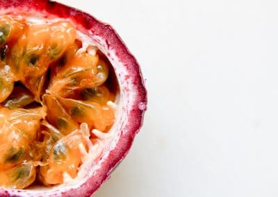 cross section of cut purple passion fruit