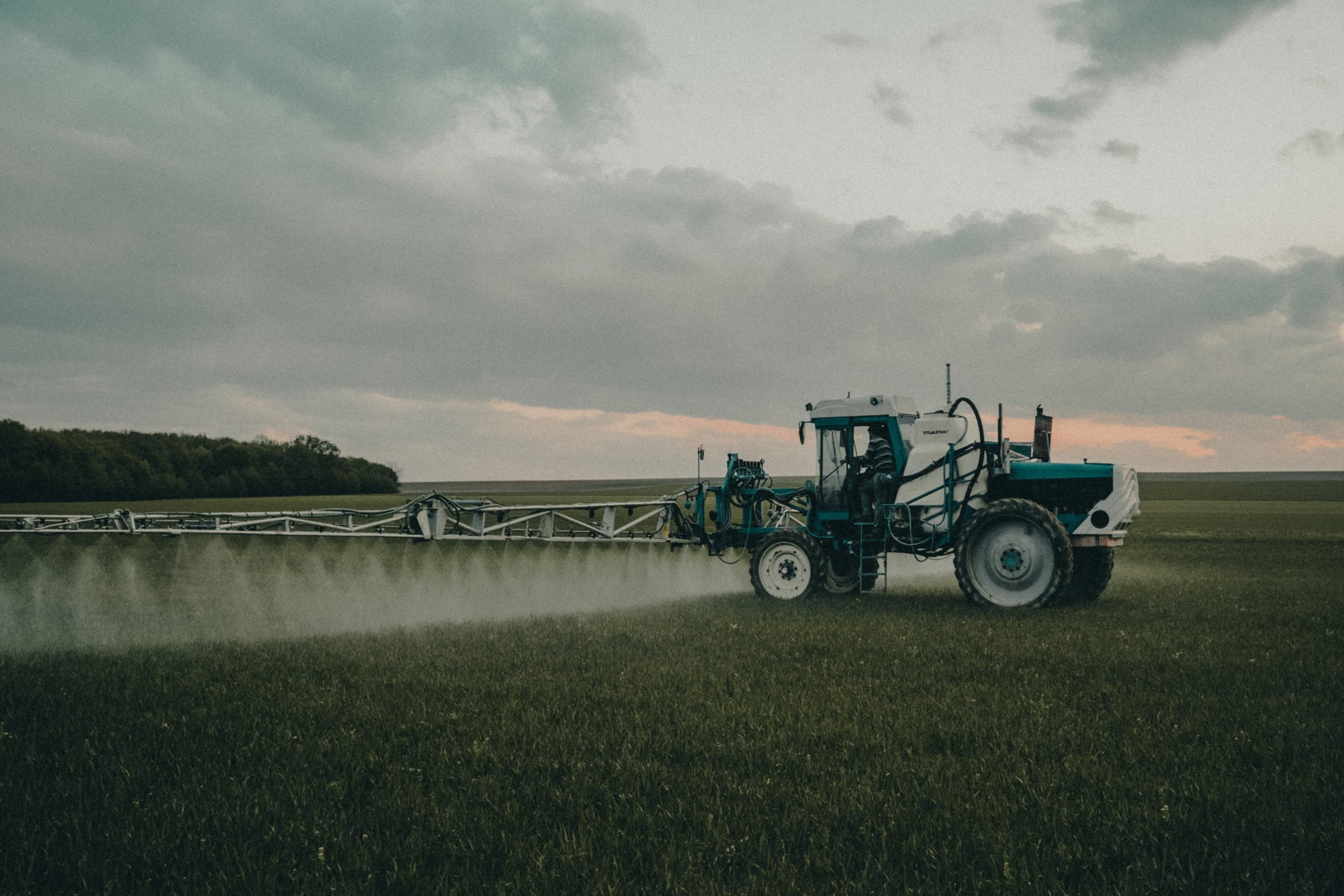 A tractor spraying a herbicide